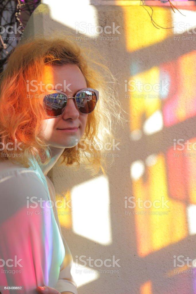 Young woman near color kaleidoscope hotspots. stock photo