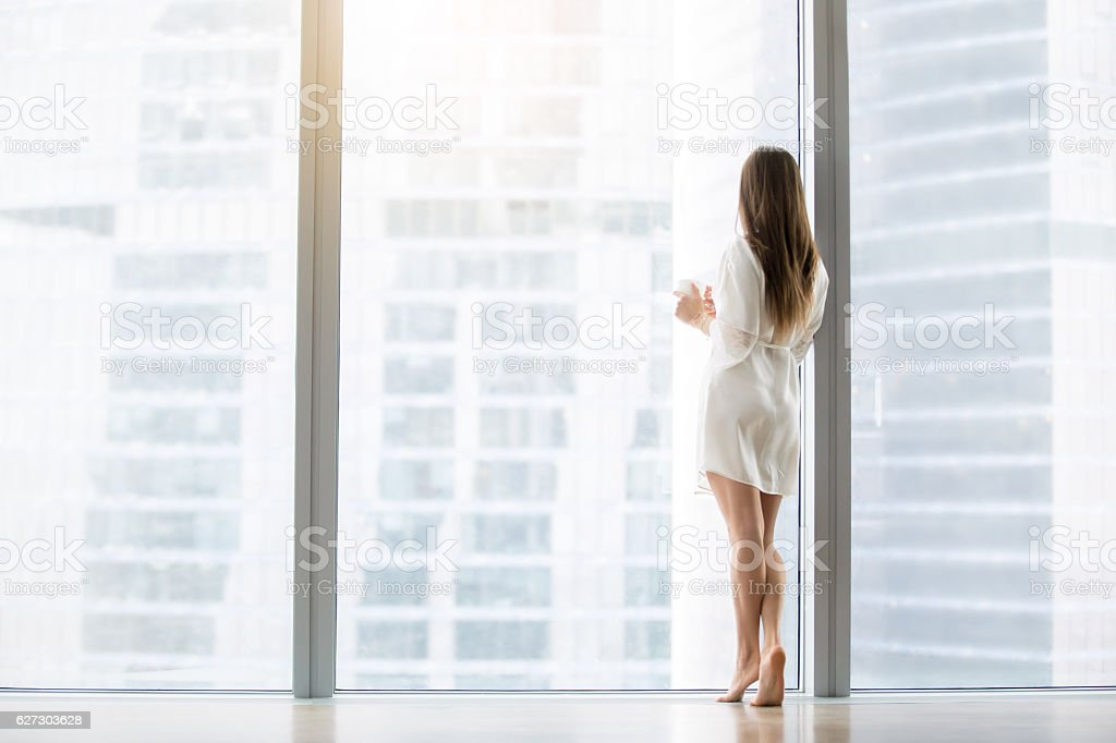 Young woman near the floor window royalty-free stock photo