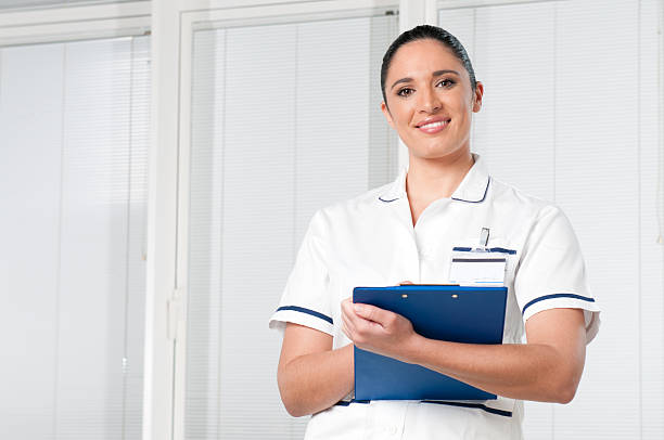 young woman nurse at hospital - female nurse stock photos and pictures