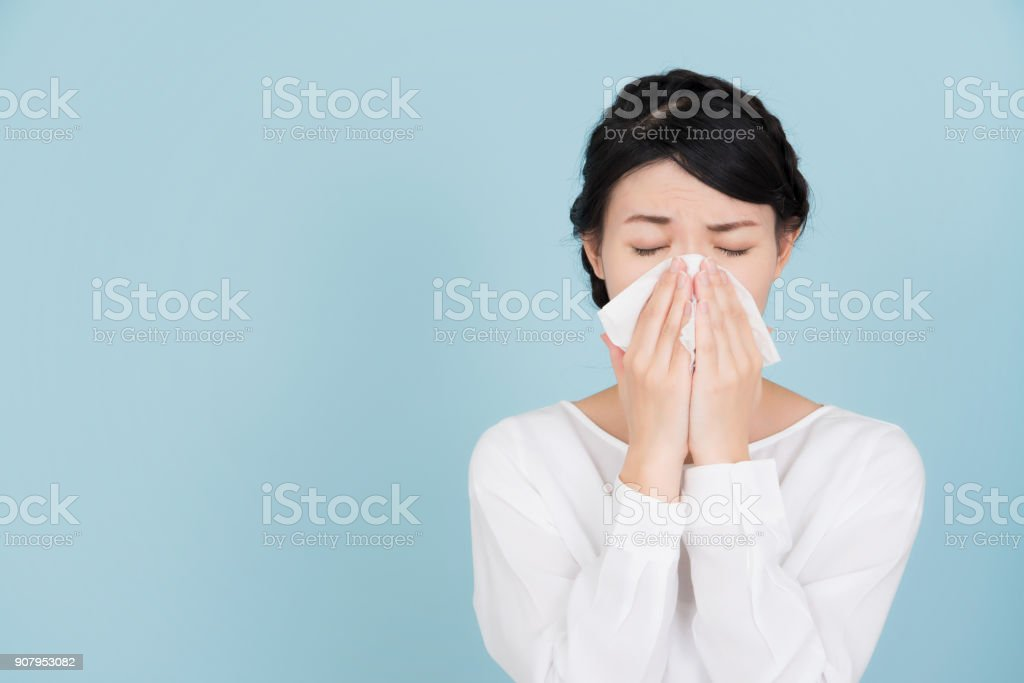 Young woman of hay fever stock photo