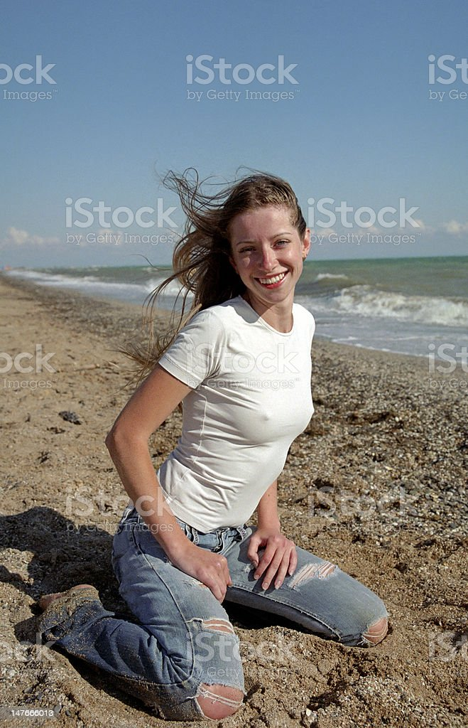 young woman on a beach royalty-free stock photo