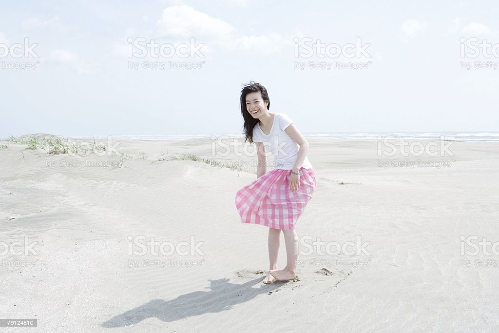 Young woman on a beach 免版稅 stock photo