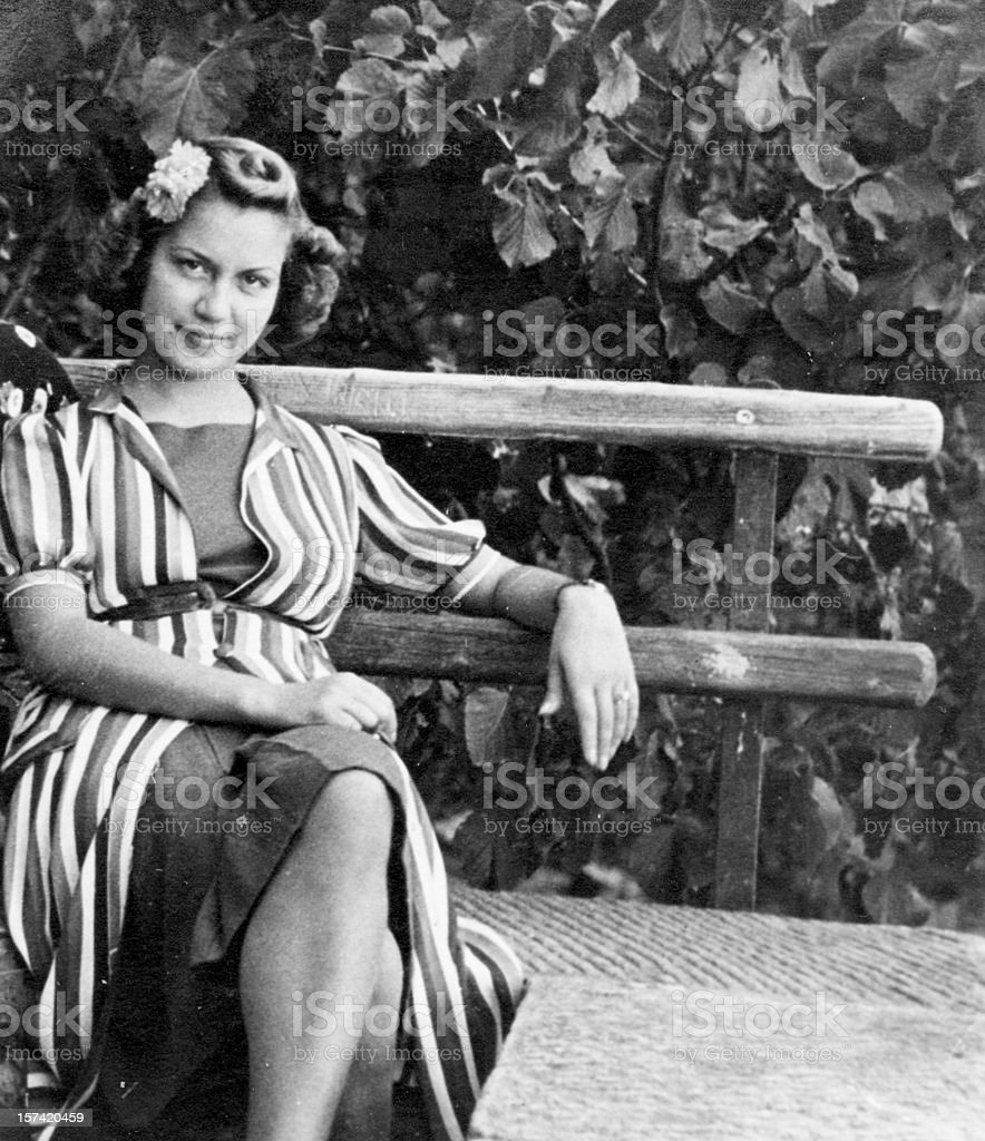 Young Woman on a Bench in 1931 Black And White stock photo