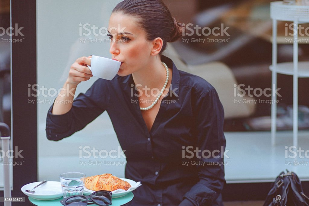 Young woman on a coffee break at cafe stock photo