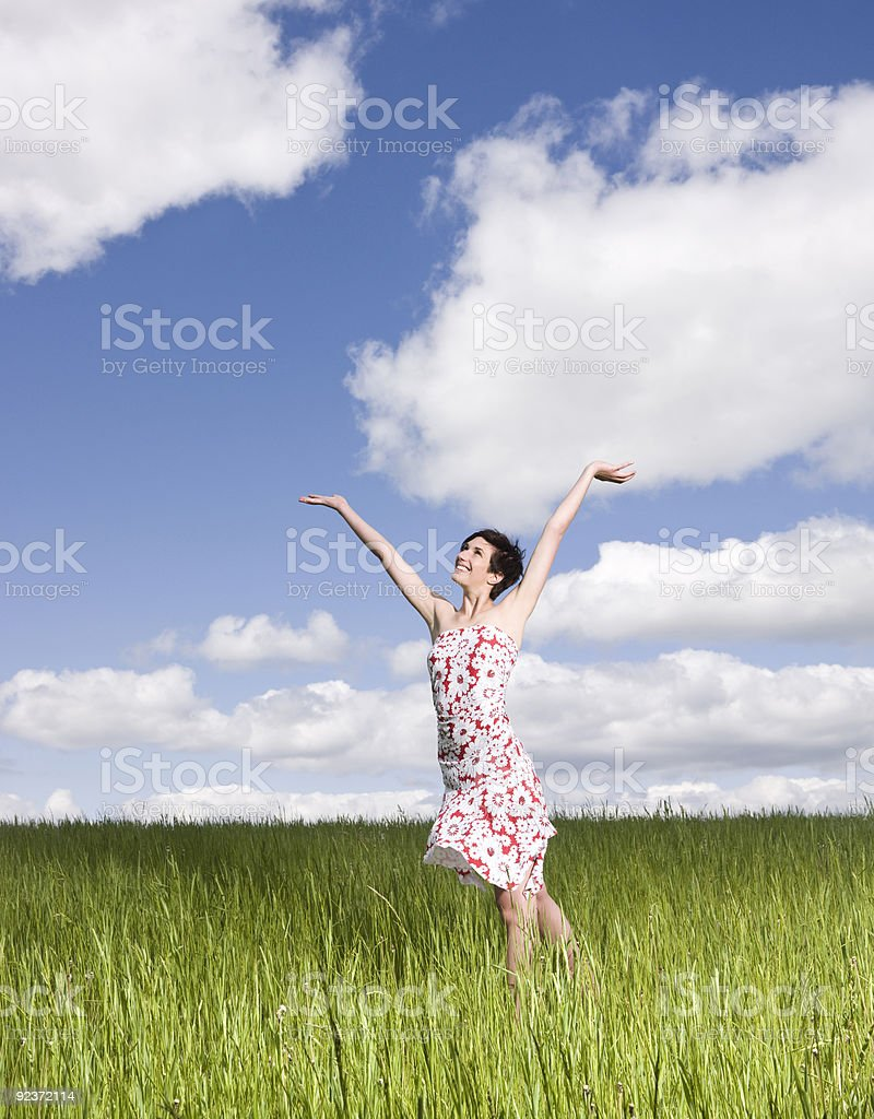 Young woman on a field royalty-free stock photo