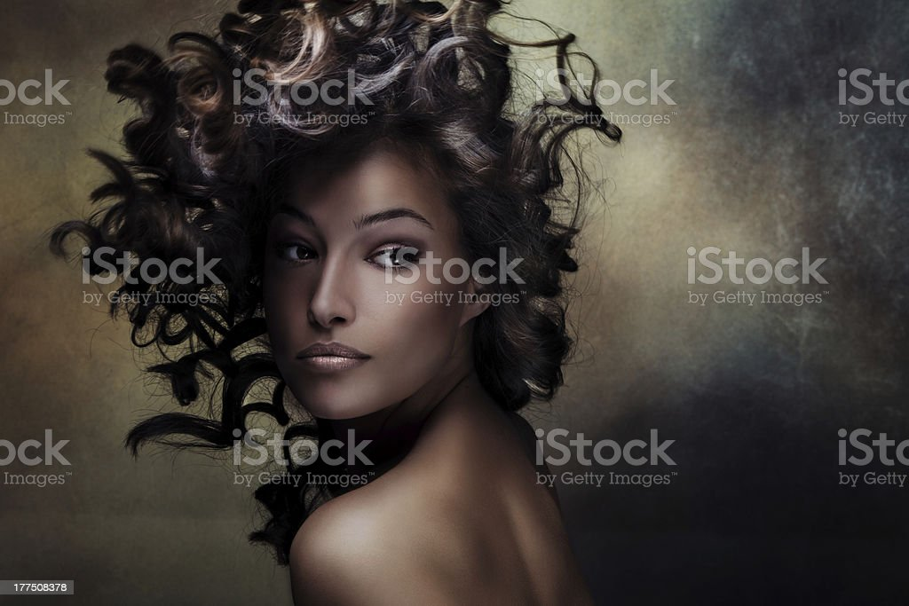 A young woman on a grunge background stock photo