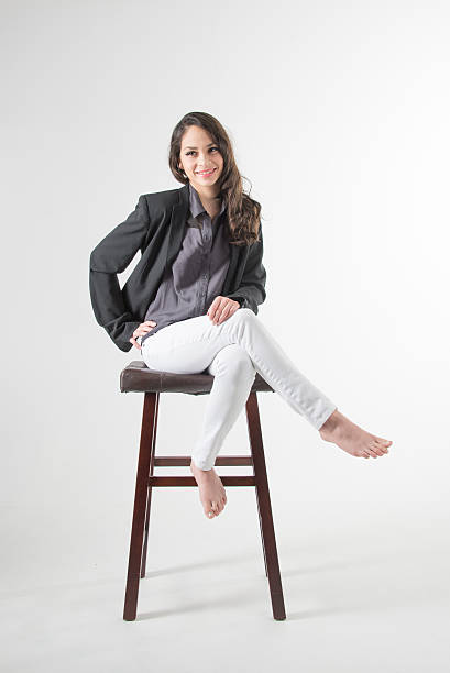 Young woman on a high stool stock photo