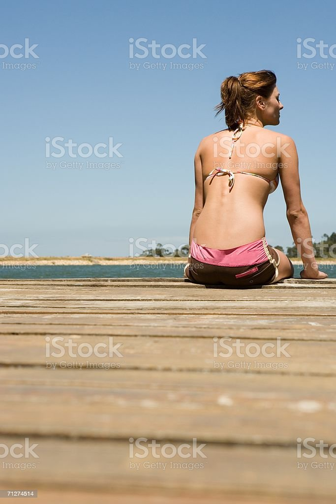 Young woman on a jetty royalty-free stock photo