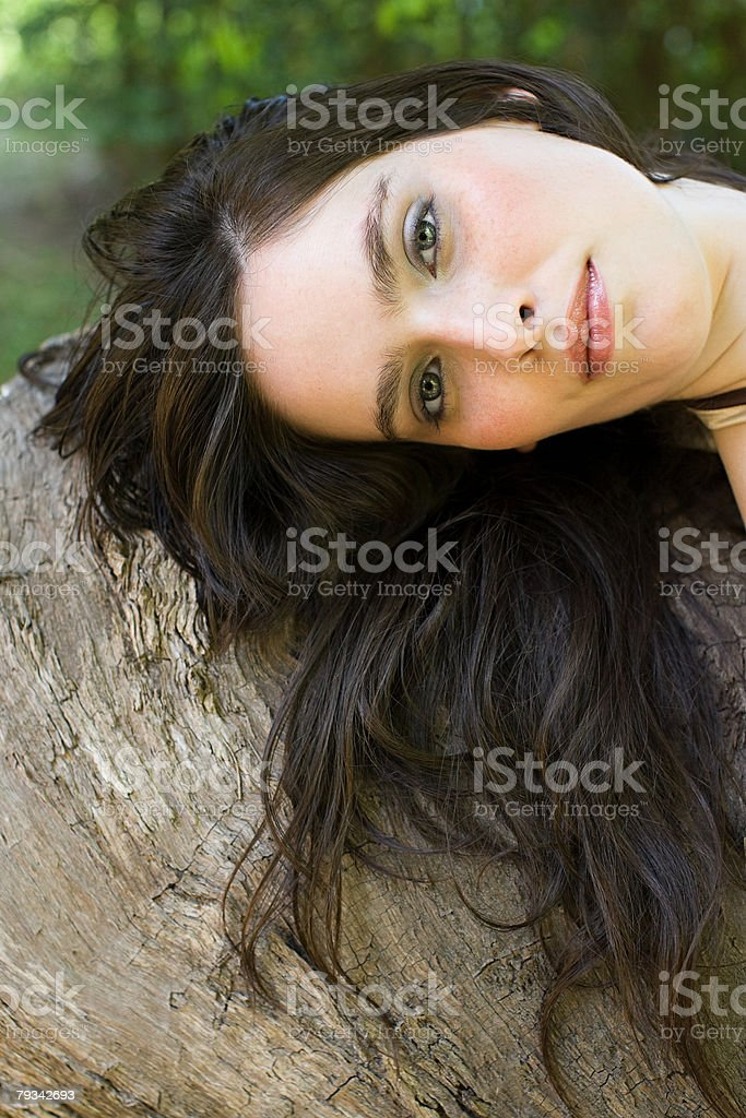 Young woman on a log royalty-free stock photo