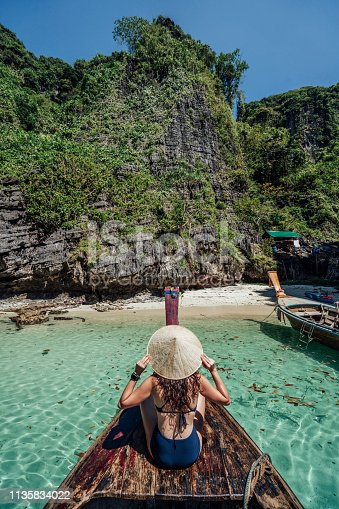 istock Young woman on a longtail boat in Thailand, Phi Phi Island 1135834022