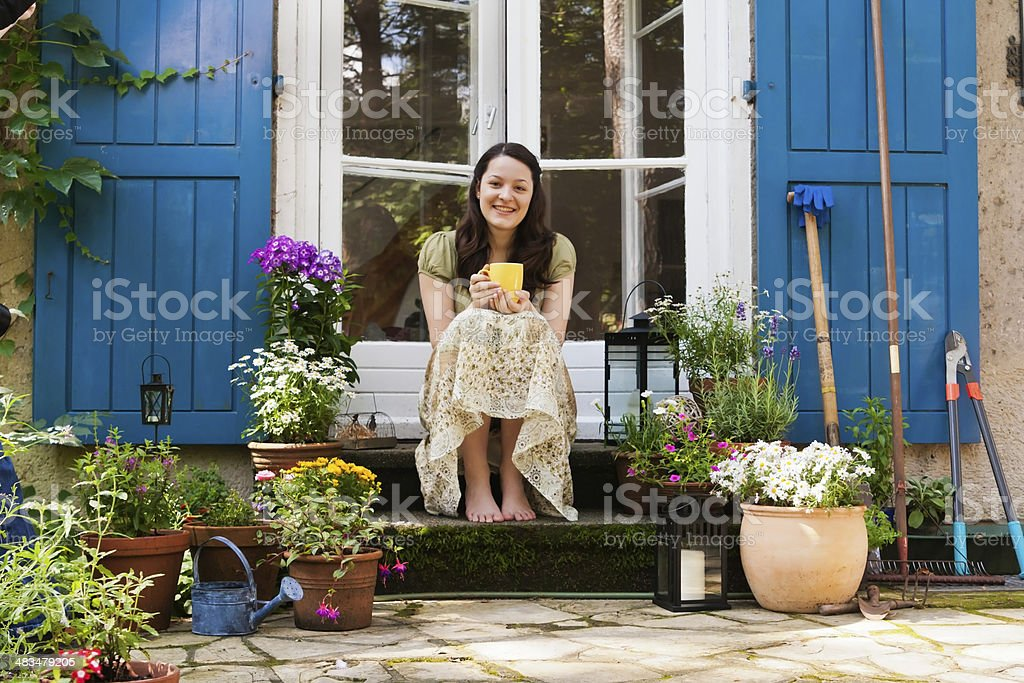 young woman on a patio