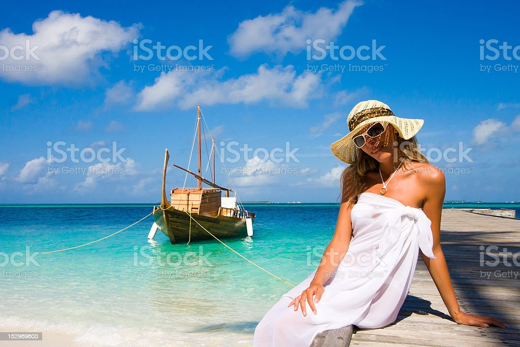 Young woman on a pier royalty-free stock photo