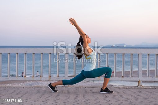 Young woman on a seafront doing sport