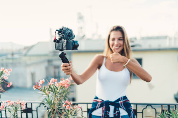 Young woman on a vacation vlogging stock photo