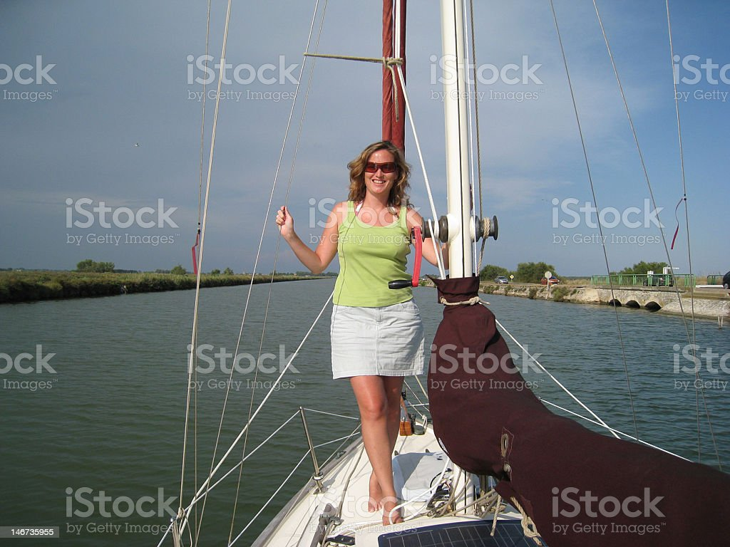 Young woman on a yacht royalty-free stock photo