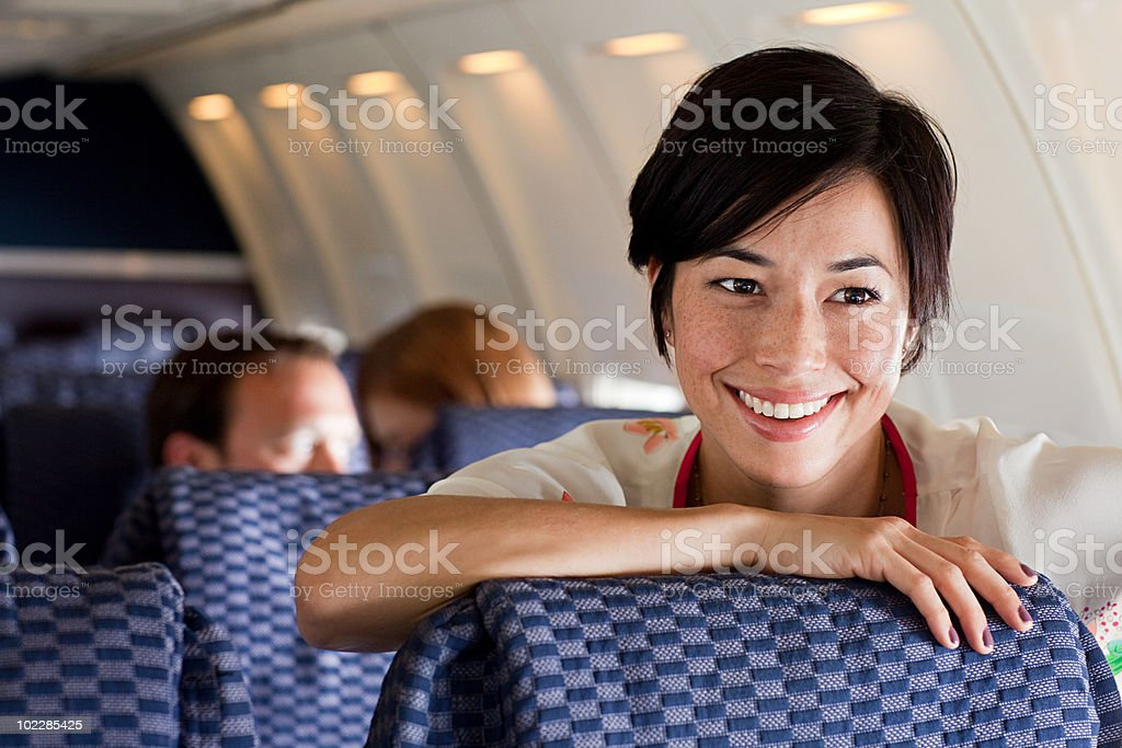 Young woman on an airplane stock photo