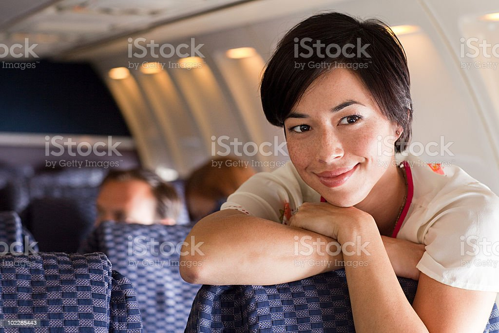 Young woman on an airplane royalty-free stock photo