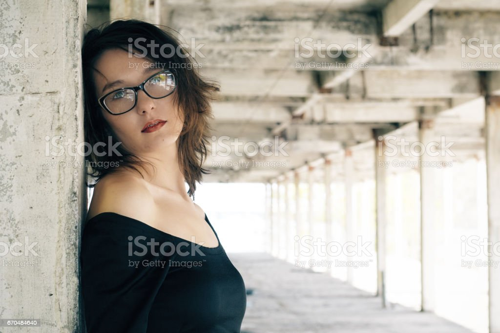 Young woman on background of the destroyed architecture. stock photo