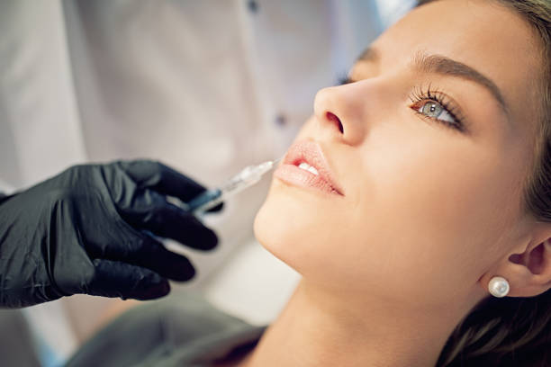Young woman on beauty treatment procedure stock photo