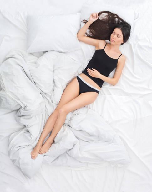 Young woman on bed top view rest concept sleeping on back uncovered picture id1185122173?b=1&k=6&m=1185122173&s=612x612&w=0&h=h47v9sqf5tnrr1kxloy247nz u3ta5pu4s0hxumlq7q=