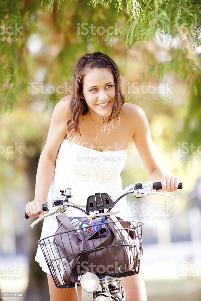 Young woman on bicycle royalty-free stock photo