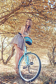 istock Young woman on bicycle 665648824