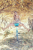 istock Young woman on bicycle 800964254
