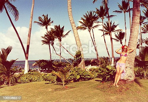 Analog bleached image of a young woman on a summer vacation