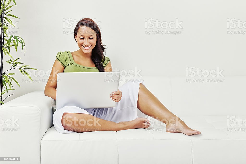 Young Woman on Couch with Laptop stok fotoğrafı