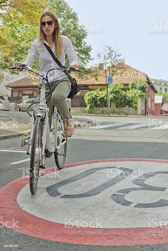 Young woman on electric bicycle royalty-free stock photo