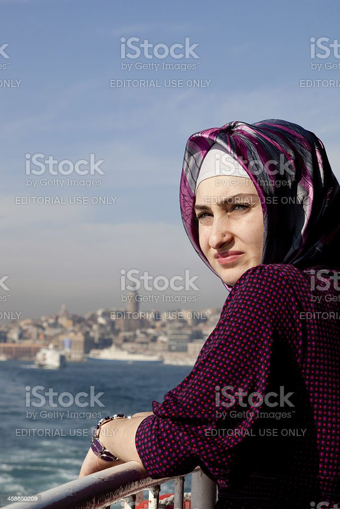Young woman on ferry in Istanbul royalty-free stock photo