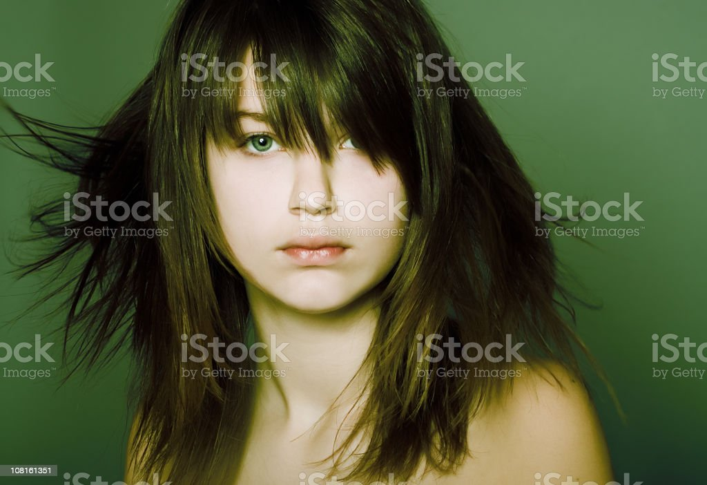 Young Woman on Green Background royalty-free stock photo