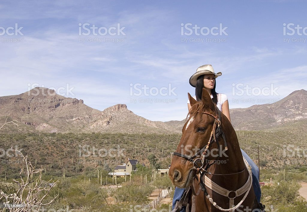 Young Woman on Horse - Afternoon Trail Ride stock photo