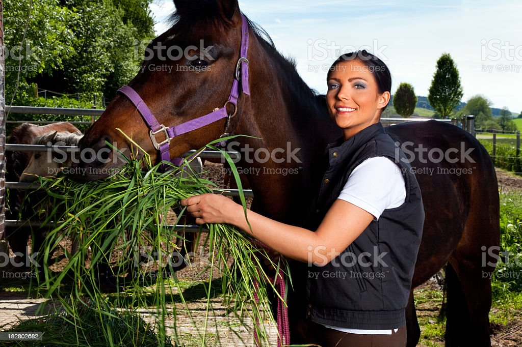 young woman on horse ranch royalty-free stock photo