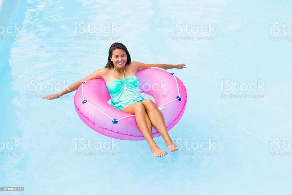 Young woman on innertube stock photo