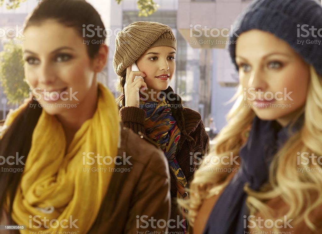 Young woman on mobile outdoors royalty-free stock photo
