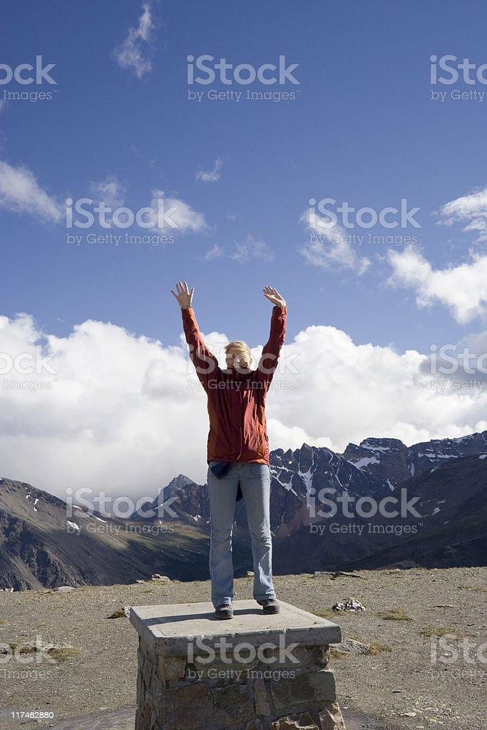 young woman on mountain peak royalty-free stock photo