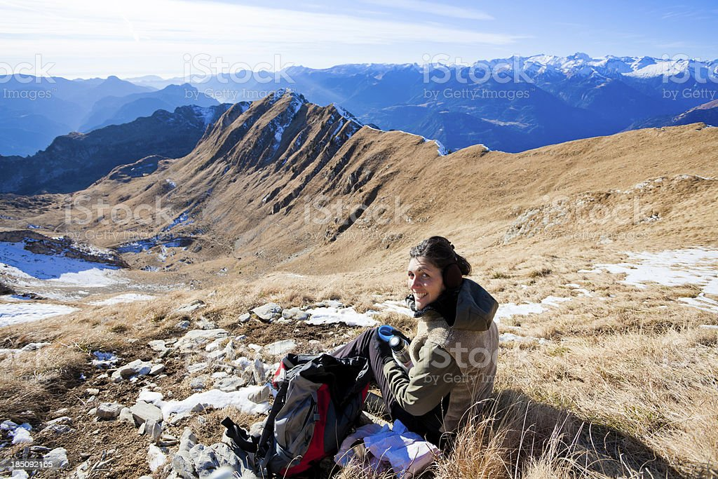 Young Woman on Mountain Top Having a Break royalty-free stock photo