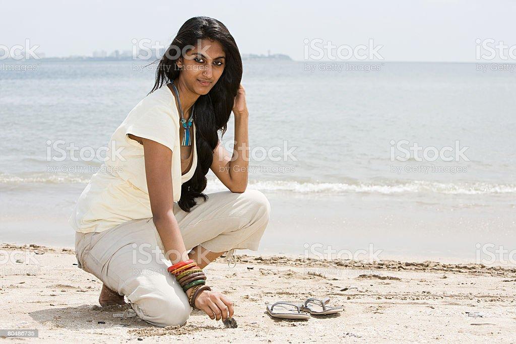 A young woman on mumbai beach 免版稅 stock photo