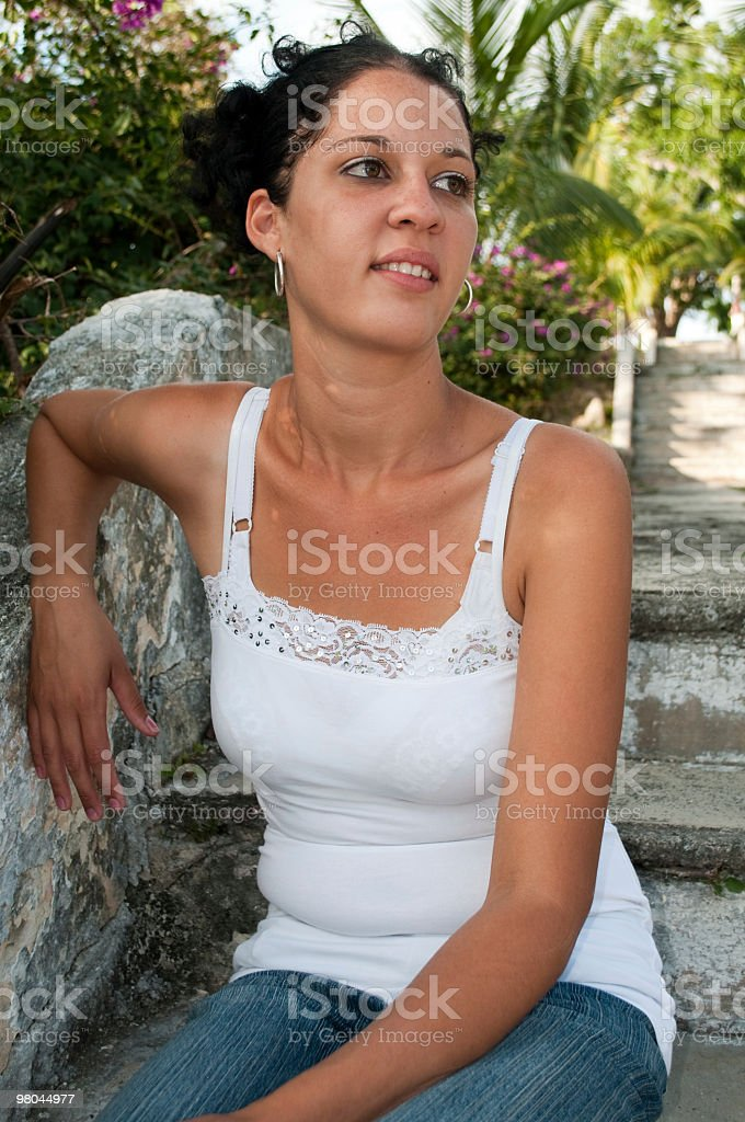 Young woman on old stone steps royalty-free stock photo