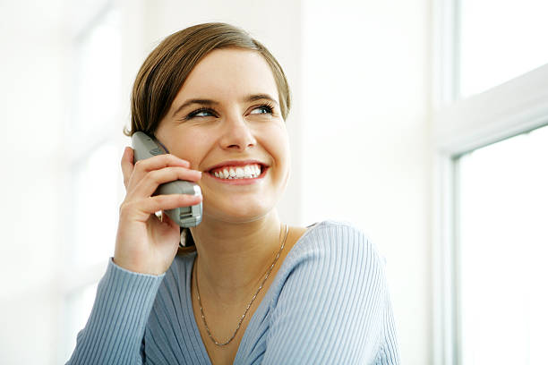 Young woman on phone  cordless phone stock pictures, royalty-free photos & images