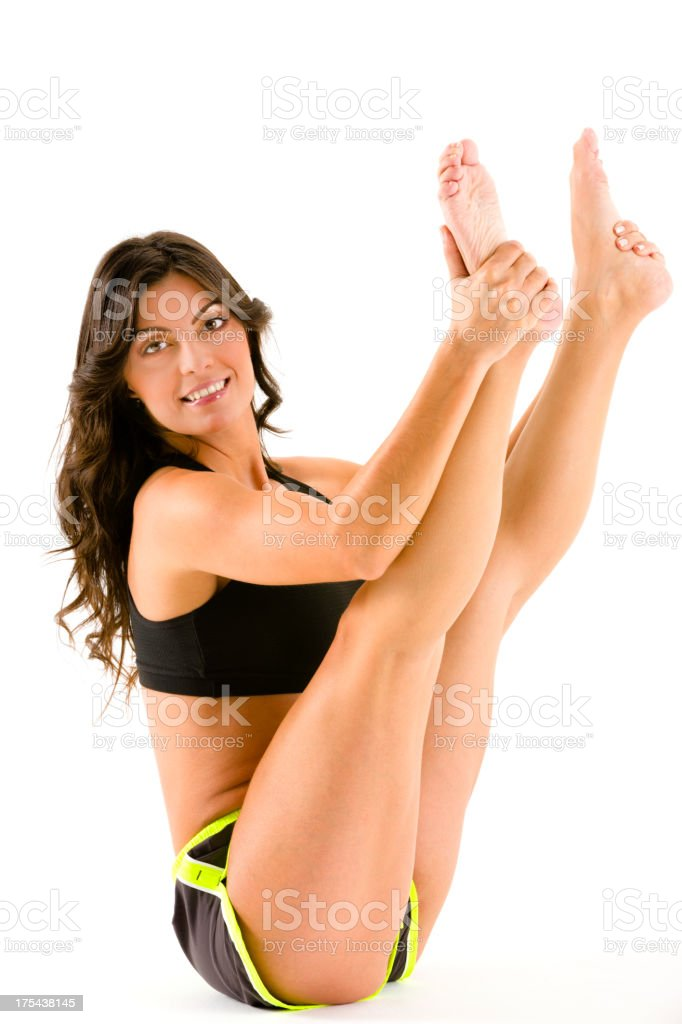 Young woman on Pilates posture during workout over white background stock photo