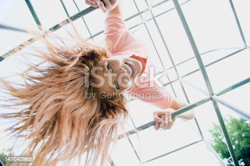 istock Young Woman on Playground Equipment 147040965