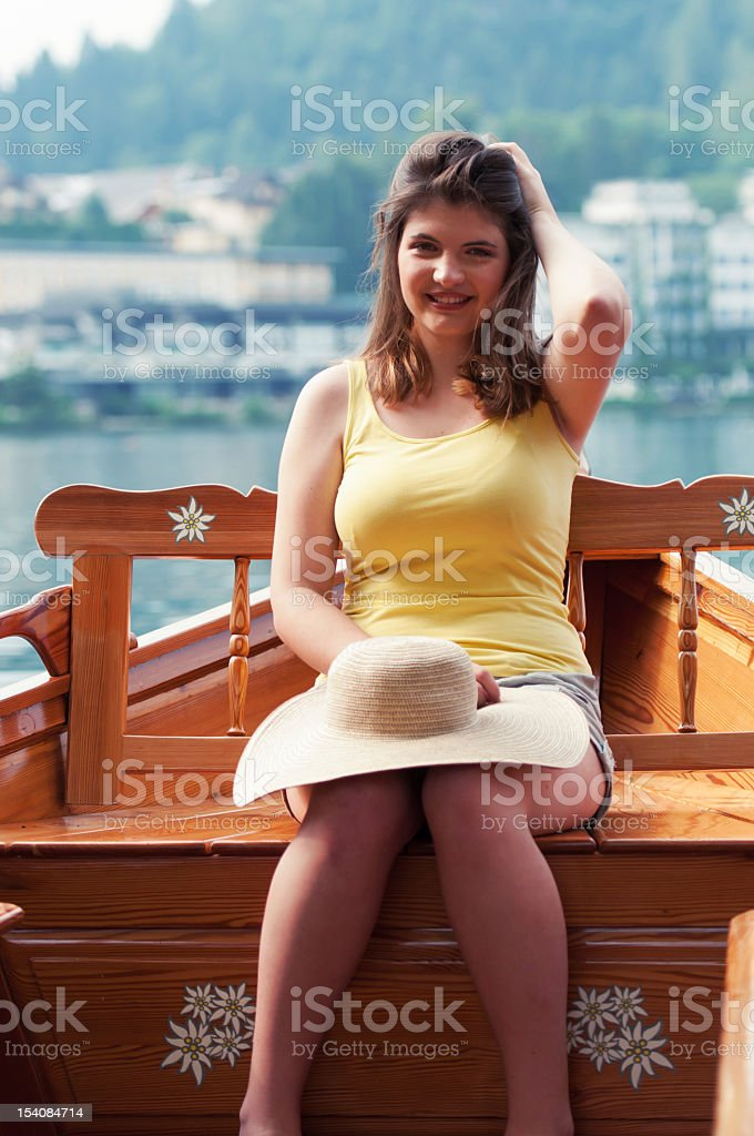 Young woman on Pletna boat stock photo