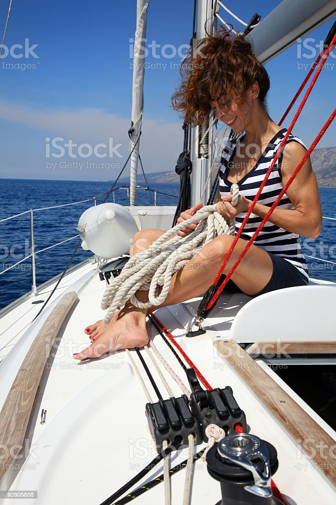 Young woman on sailing boat royalty-free stock photo