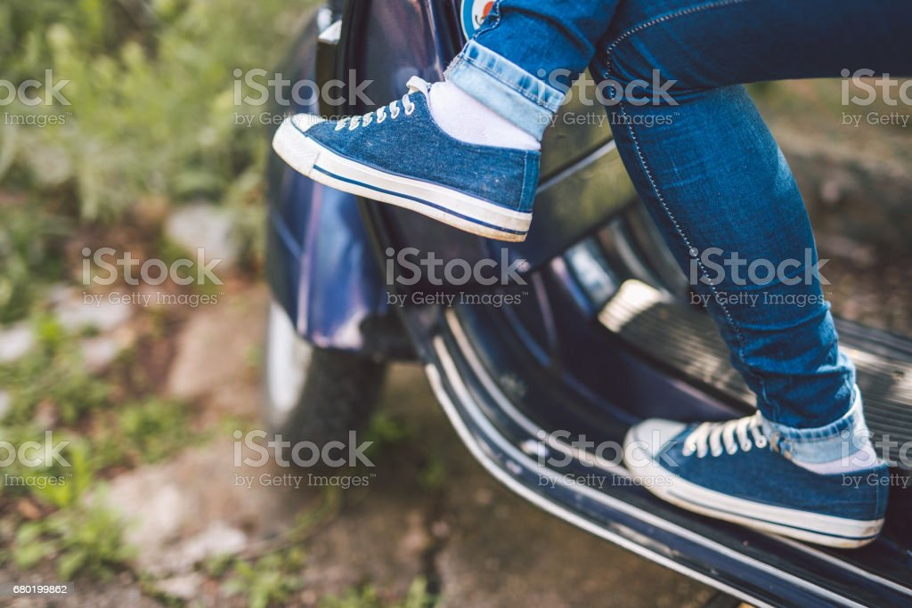 Young woman on scooter stock photo