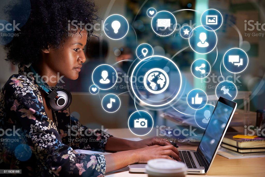 Young woman on social media with holographic icons stock photo