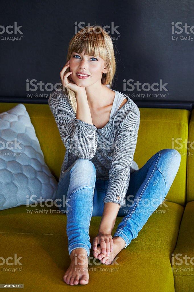 Young woman on sofa stock photo