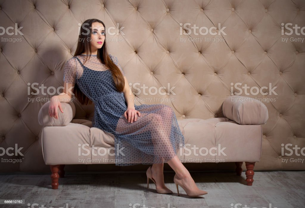Young woman on sofa royalty-free stock photo