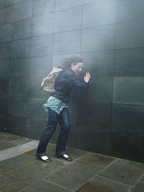 young woman on street caught in rainstorm, eyes closed - drenched stock pictures, royalty-free photos & images
